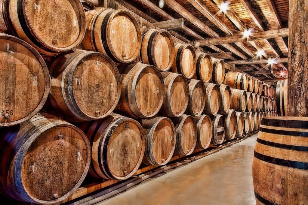 Oak barrels maturing beer in Belgium